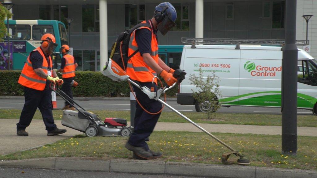Ground Control grounds maintenance staff cut grass using battery powered strimmers and mowers